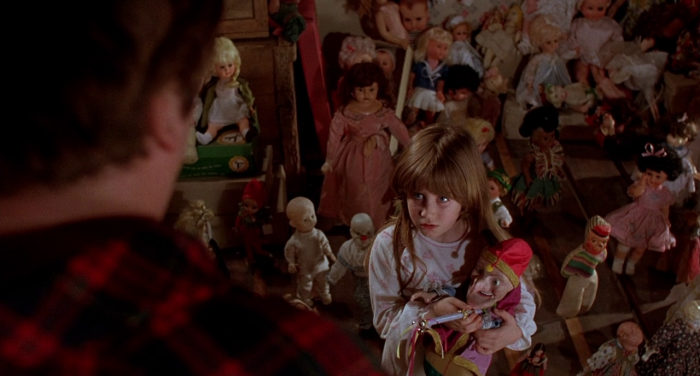 Surrounded by scary killer dolls in Dolls (1987)