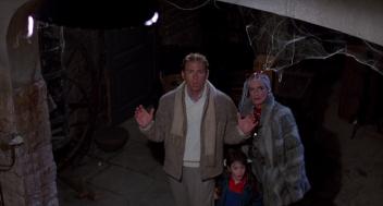 Carolyn Purdy Gordon in key scene from Dolls (1987) killer doll horror Blu-ray review